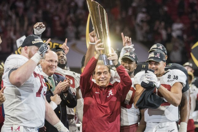 Alabama Crimson Tide head coach Nick Saban hoists the National Championship trophy after defeating the Georgia Bulldogs in the NCAA College Football Playoff National Championship Game on January 8, 2018 at Mercedes-Benz Stadium in Atlanta. Photo by Mark Wallheiser/UPI
