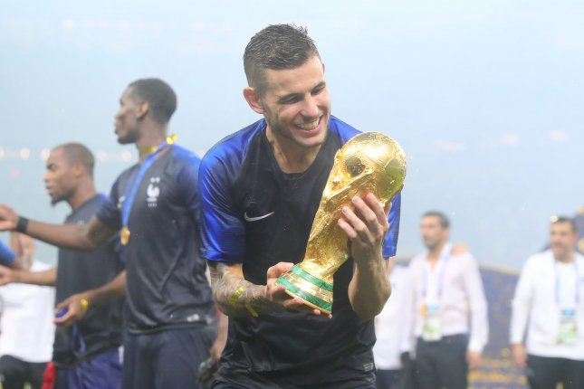Lucas Hernandez of France poses with the trophy following the 2018 FIFA World Cup final match at Luzhniki Stadium in Moscow, Russia, on July 15, 2018. France beat Croatia 4-2. Photo by Chris Brunskill/UPI