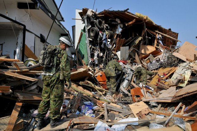 Members of Japan Ground Self-Defense Force search for victims as destruction is seen in Ishinomaki, Miyagi prefecture, Japan, on April 14, 2011. The area is still recovering from the massive 9.0 earthquake and tsunami last month. UPI/Keizo Mori