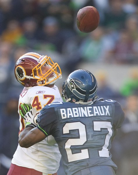 Washington Redskins tight end Chris Cooley catches a pass for 21 yards while being defended by Seattle Seahawks strong safety Jordan Babineaux in the third quarter at Qwest Field in Seattle on November 23, 2008. Cooley caught five passes for 54 yards in the Redskins 20-17 win over the Seahawks. (UPI Photo/Jim Bryant)