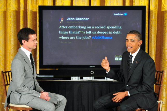 President Barack Obama responds to a question from Speaker of the House John Boehner, (R-Ohio, alongside Twitter co-founder Jack Dorsey, during the White House Twitter Town Hall in Washington, July 6, 2011. President Obama answered questions posted by twitter users. UPI/Kevin Dietsch