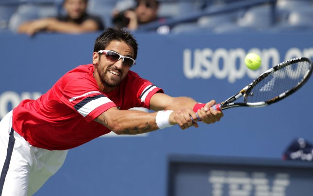 Janko Tipsarevic, shown in a file photo from the 2011 U.S. Open, needed three sets Thursday but still advanced to the quarterfinals of the Kremlin Cup tennis tournament in Moscow. UPI/John Angelillo