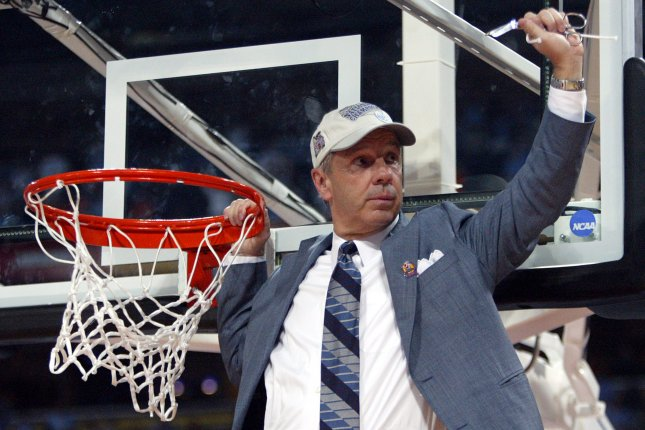 North Carolina's head basketball coach Roy Williams points to fans after cutting down the net after defeating Illinois to win the NCAA Men's basketball national championship at the Edward Jones Dome in St. Louis on April 4, 2005. (File/UPI Photo/Bill Greenblatt)