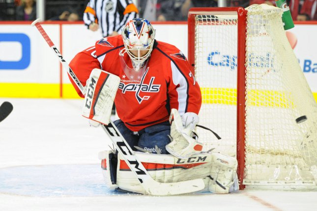 Washington Capitals goalie Braden Holtby (70) makes a save on shot by the Vancouver Canucks in the first period at the Verizon Center in Washington, D.C. on January 14, 2016. Photo by Mark Goldman/UPI