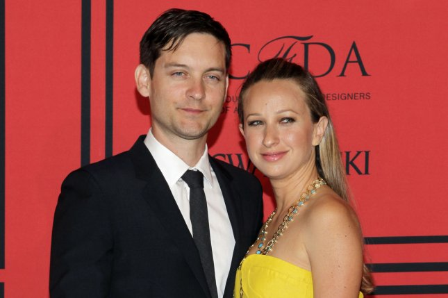 Tobey Maguire and Jennifer Meyer arrive on the red carpet at the 2013 CFDA Fashion Awards at Lincoln Center's Alice Tully Hall in New York City on June 3, 2013. The pair announced they are separating after nine years of marriage. File Photo by John Angelillo/UPI