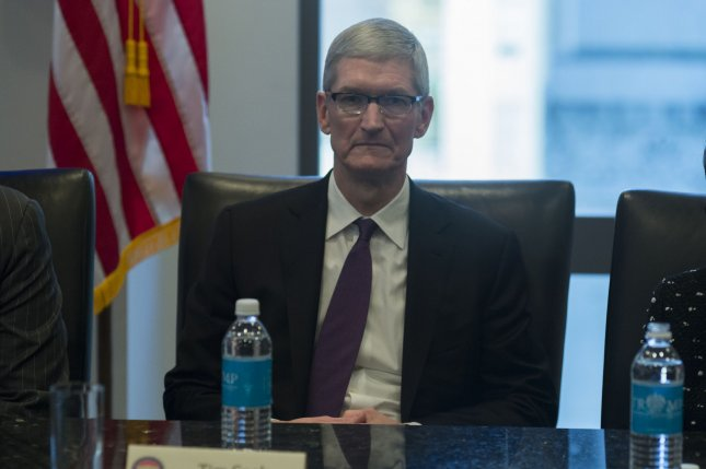 Earlier this month, Apple CEO Tim Cook spoke about Apple's development of technology for self-driving cars. Pool photo by Albin Lohr-Jones/UPI