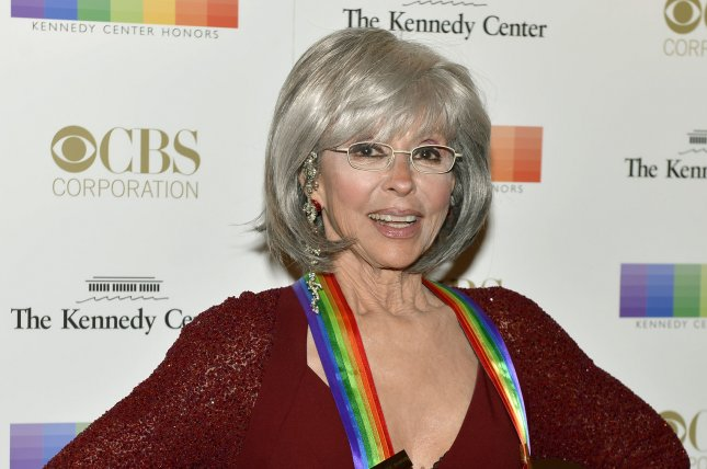 Kennedy Center Honoree and Academy Award-winning actress and singer Rita Moreno poses for photographers on the red carpet as she arrives for an evening of gala entertainment at the Kennedy Center on December 6, 2015. She turns 86 on December 11. File Photo by Mike Theiler/UPI