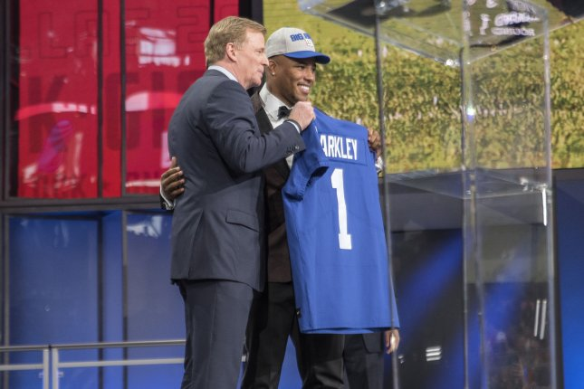 Saquon Barkley celebrates with NFL Commissioner Roger Goodell after being chosen as the second overall pick by the New York Giants in the 2018 NFL Draft on April 26 at AT&T Stadium in Arlington, Texas. File Photo by Sergio Flores/UPI