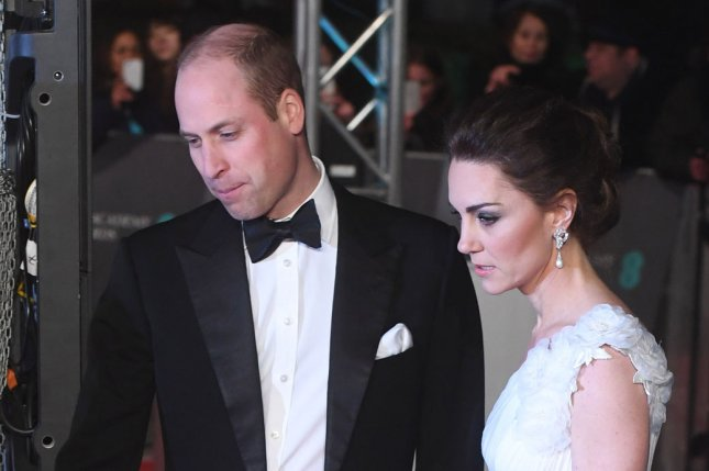 Prince William (L) and Kate Middleton shared three new pictures of Prince Louis in honor of his birthday. File Photo by Rune Hellestad/UPI