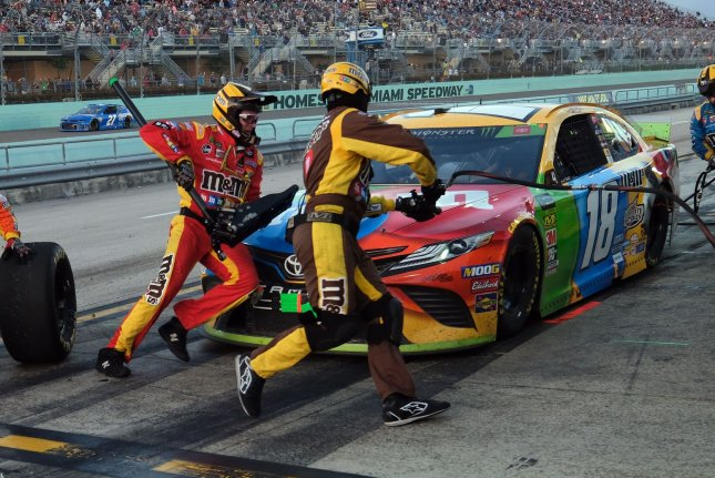 Kyle Busch (18) will have to wait for the third leg of his attempt to race in 7 events in 11 days after Tuesday's Xfinity Series event was postponed to Thursday. File Photo By Gary I Rothstein/UPI