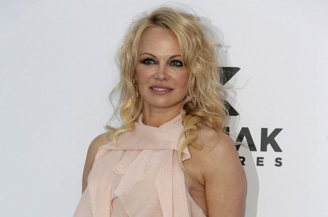 Pamela Anderson married her bodyguard Dan Hayhurst at her Canada home on Christmas Eve. File Photo by Sven Hoogerhuis/UPI