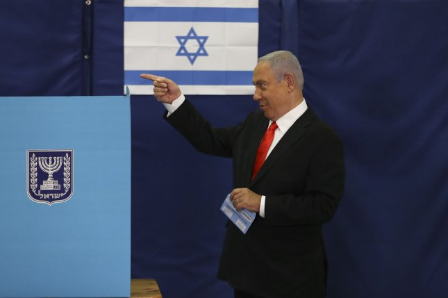 Israeli Prime Minister Benjamin Netanyahu votes during the general election on Tuesday at a polling station in Jerusalem, Israel. Photo by Ronen Zvulun/UPI/Pool