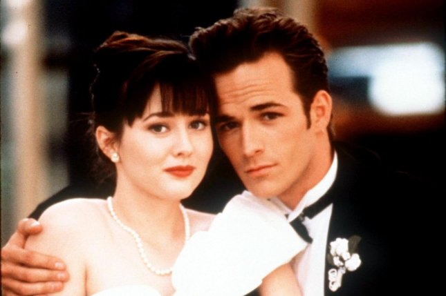 Brenda (Shannen Doherty, L) and Dylan (Luke Perry) at the high school Spring Dance in 1991 on Beverly Hills, 90210. File photo by UPI