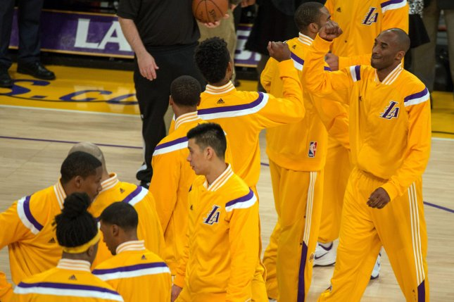 Los Angeles Lakers guard Kobe Bryant bumps elbows with teammate Nick Young prior to game against the Oklahoma City Thunder at Staples Center in Los Angeles, November 19, 2014. The Thunder defeated the Lakers 104-103. UPI/Jon SooHoo