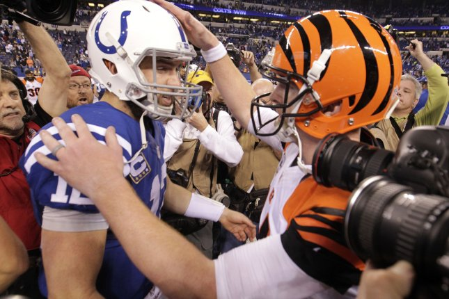 Indianapolis Colts quarterback Andrew Luck (12) shakes hands with Cincinnati Bengals quarterback Andy Dalton (14) after defeating the Bengals 26-10 in their NFL Wild Card game at Lucas Oil Stadium in Indianapolis, Indiana, on Jan. 4, 2015. Photo by John Sommers II/UPI