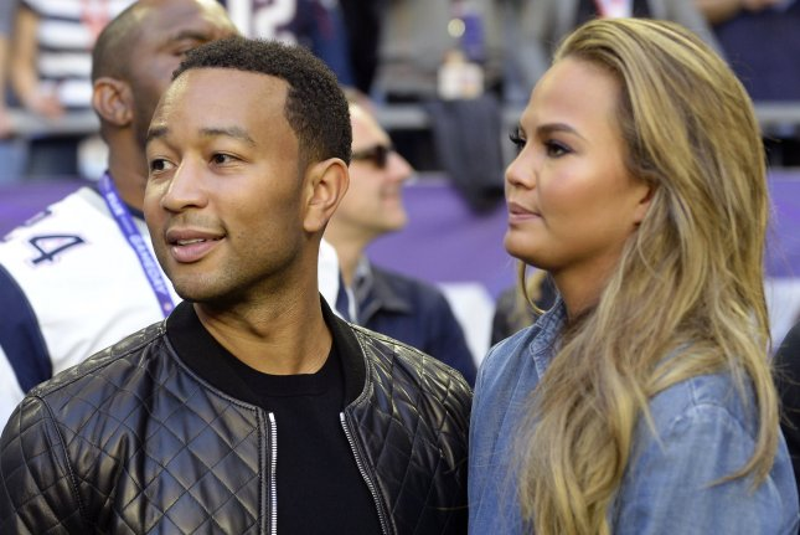 John Legend (L) and wife Chrissy Teigen at Super Bowl XLIX on February 1, 2015. Photo by David Tulis/UPI