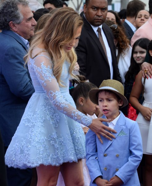 Cast member Jennifer Lopez, the voice of Lucy in the animated sci-fi comedy Home attends the premiere of the film with son Maximilian David Muniz and daughter Emme Maribel Muniz at the Regency Village Theatre in the Westwood section of Los Angeles on March 22, 2015. Storyline: Oh (Jim Parsons), an alien on the run from his own people, lands on Earth and makes friends with the adventurous Tip (Rihanna), who is on a quest of her own. Photo by Jim Ruymen/UPI