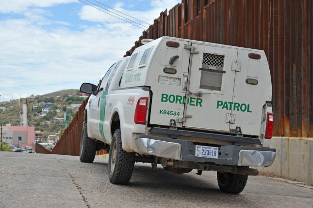 A United States Border Patrol truck sits next to the border fence between the U.S. and Mexico near Nogales, Az., on July 13, 2014. Friday, a federal judge ordered the Obama administration to begin releasing hundreds of immigrant mothers and children being held in government family detention centers. Photo by Art Foxall/UPI