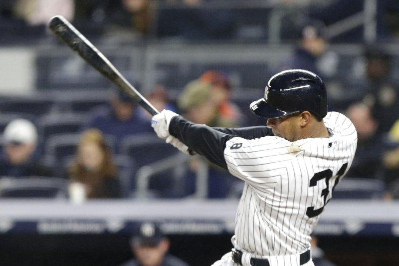 New York Yankees' Aaron Hicks hits the ball. File photo by John Angelillo/UPI