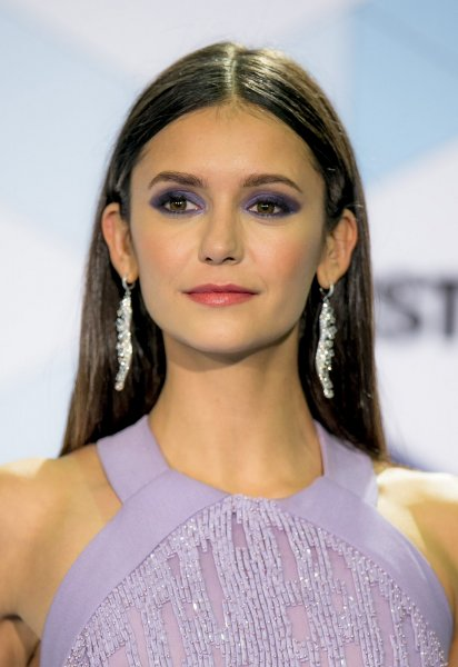 Nina Dobrev arrives in the photo room during the MTV Europe Music Awards on November 6, 2016. The actress will soon be seen in the movie Flatliners. File Photo by Sven Hoogerhuis/UPI