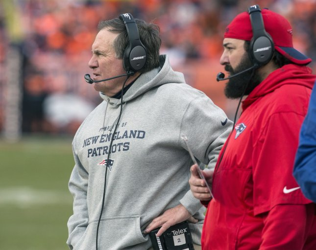 Former New England Patriots defensive coordinator and current Detroit Lions coach Matt Patricia (R) looks on from the sidelines next to Patriots head coach Bill Belichick during a game against the Denver Broncos in 2016. Photo by Gary C. Caskey/UPI