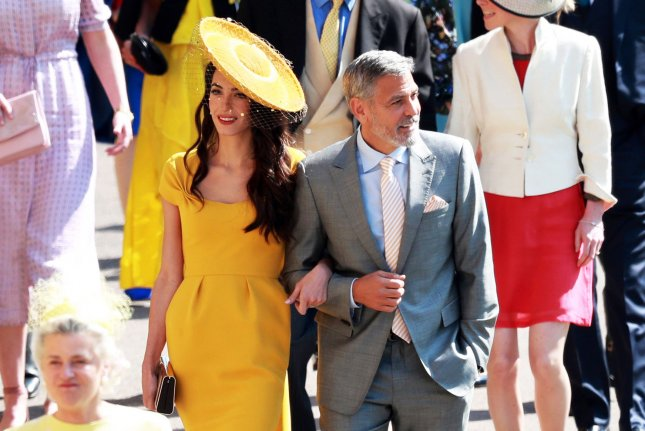 Actor George Clooney (R) and his wife, British human rights barrister Amal Clooney, arrive for the royal wedding ceremony of Britain's Prince Harry and Meghan Markle at St George's Chapel in Windsor Castle, in Windsor, Britain, on Saturday. Pool Photo by Lauren Hurley/UPI