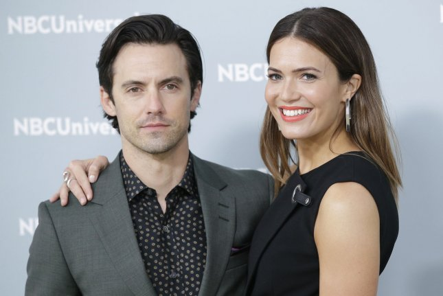 Mandy Moore (R), pictured with Milo Ventimiglia, dedicated a sweet post to the actor on his 41st birthday. File Photo by John Angelillo/UPI