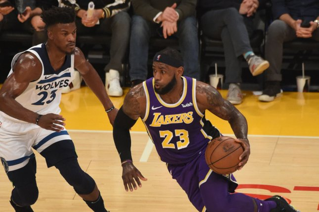 Los Angeles Lakers star LeBron James (R) drives to the basket while defended by the Minnesota Timberwolves' Jimmy Butler on November 7 at Staples Center in Los Angeles. Photo by Jon SooHoo/UPI