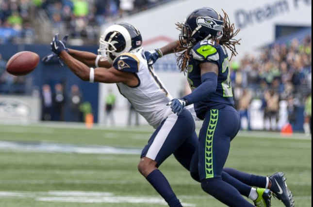 Seattle Seahawks cornerback Shaquill Griffin (26) is called for pass interference while guarding Los Angeles Rams wide receiver Robert Woods (17) during the third quarter of a game October 7, 2018, at CenturyLink Field in Seattle, Washington. Photo by Jim Bryant/UPI