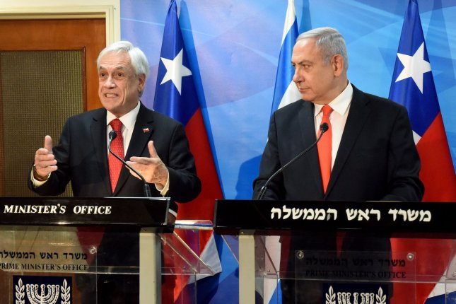 Israeli Prime Minister Benjamin Netanyahu (R) listens to Chilean President Sebastian Pinera during statements to the press at his office in Jerusalem. Photo by Debbie Hill/UPI