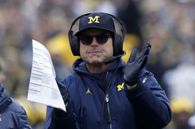 Michigan Wolverines head football coach Jim Harbaugh's letter also proposes a blanket five-year eligibility clock for players with no need for a redshirt. File Photo by Aaron Josefczyk/UPI