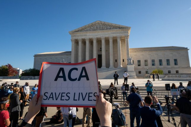 Demonstrators show their support for the Affordable Care Act in front of the Supreme Court in Washington, D.C., on Tuesday. Photo by Ken Cedeno/UPI