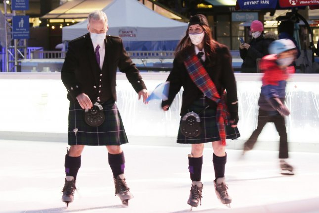 Masked ice skaters wear kilts and Scottish argyle outfits Thursday at the ASF Tartan Kiltskate at the Bryant Park Skating Rink in New York City. Photo by John Angelillo/UPI