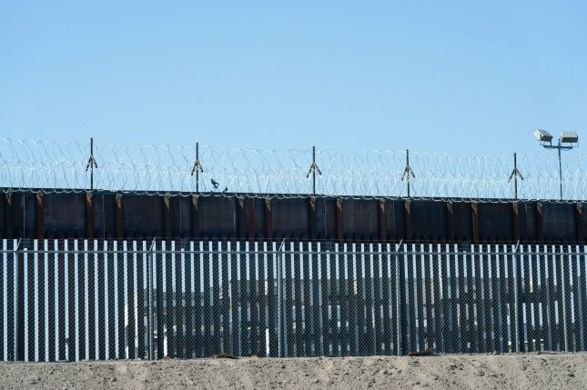 The Department of Homeland Security canceled two contracts for further construction of the Mexico-U.S. border wall, part of which is seen at the Paso del Norte Port of Entry wall near El Paso, Texas, in June. File Photo by Yuri Gripas/UPI