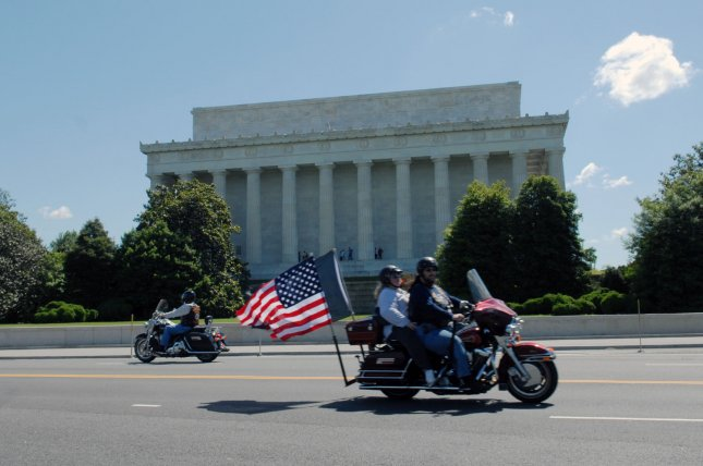Motorcyclists ride by the Lincoln Memorial during Memorial Day weekend in Washington on May 24, 2008. Members of the Rolling Thunder organization, a veterans advocacy organization that works for the return of prisoners of war and missing in action from all of the conflicts of the United States, annually visits Washington D.C. during Memorial Day weekend. (UPI Photo/Alexis C. Glenn)