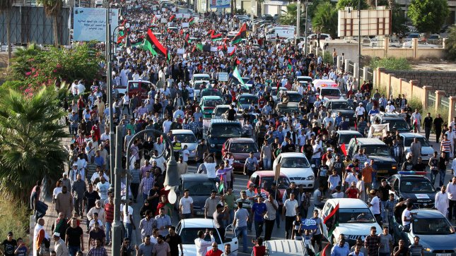 Shows Libyan protesters demonstrating during march an anti hardline Islamist in Benghazi, Libya, 21 September 2012. Hundreds of Libyan protesters forced members of a hardline Islamist militia out of their base in the second city of Benghazi, setting fire to and wrecking the military compound. UPI/Tariq AL-hun.