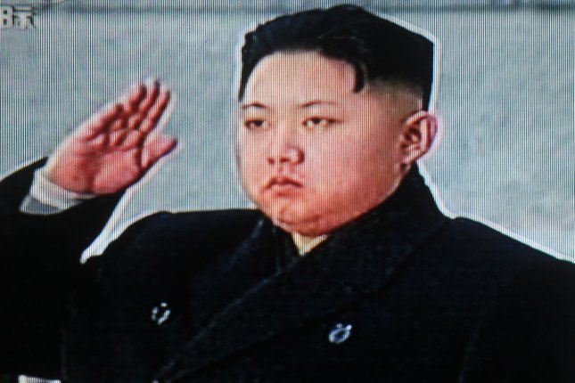 Kim Jong-un, pictured here on China state television saluting his father during a state funeral in December 2011, has reportedly fired his uncle, Jang Song-thaek sometime in the last month or two. (UPI/Stephen Shaver)