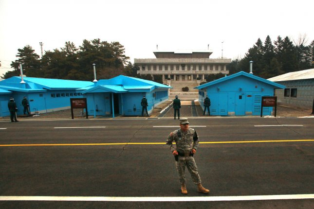 A U.S. soldier stands watch with South Korean military police in front of the the southern side of the Joint Security Area's (JSA) demarcation line separating South Korea from North Korea (in the background) in the Demilitarized Zone (DMZ) in Seoul on January 29, 2013. U.S. Forces Korea has agreed to a joint U.S.-South Korea investigation of a live anthrax shipment to Osan Air Base. UPI/Stephen Shaver