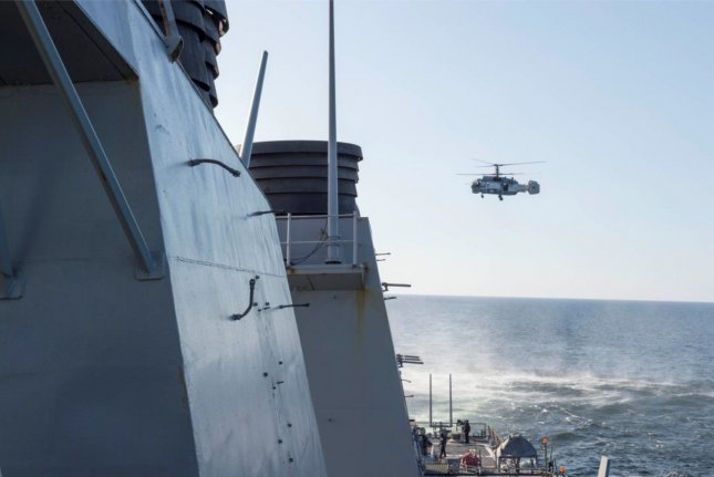 A Russian Kamov KA-27 Helix closely surveils the USS Donald Cook (DDG 75) on April 12, 2016, during maneuvers in international waters in the Baltic Sea. Russia announced it has developed an underwater surveillance system that will be able to track all ships in the world's oceans. It is scheduled to be in operation by 2020. Photo by U.S. Navy/UPI