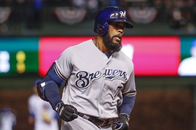 Milwaukee Brewers' Eric Thames runs the bases after hitting a home run. File photo by Kamil Krzaczynski/UPI