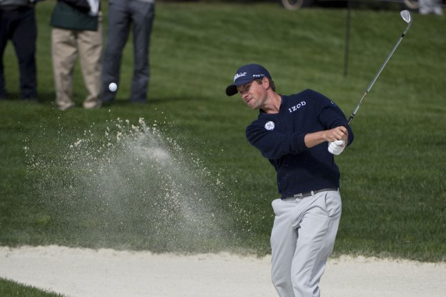 Webb Simpson hits out of the sand on the first hole of the World Golf Championship Cadillac Match Play at Harding Park in San Francisco. File photo by Terry Schmitt/UPI