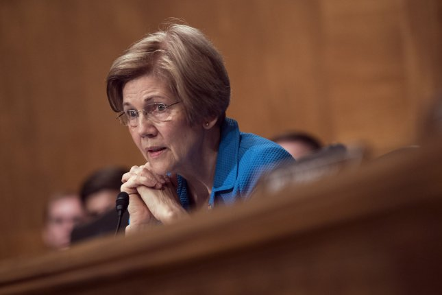 Sen. Elizabeth Warren opposes President Donald Trump's nominee to lead the Consumer Financial Protection Bureau for her support of the administration's immigration policies. File Photo by Kevin Dietsch/UPI