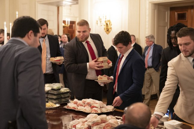 Members of the Clemson Tigers football team prepare to dine on fast food served by President Trump to celebrate their Championship at the White House in Washington, D.C. on Monday. Photo by Chris Kleponis/UPI