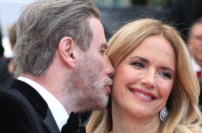 Actor John Travolta kisses his wife, Kelly Preston, before the screening of Solo: A Star Wars Story at the Cannes International Film Festival in 2018. She died Sunday at age 57. File Photo by David Silpa/UPI