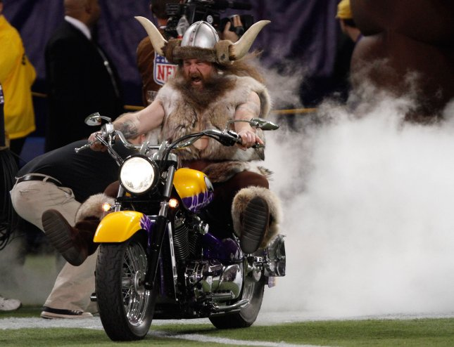 Joseph Juranitch, the Minnesota Vikings mascot Ragnar, rides a motorcycle onto the at the Hubert H. Humphrey Metrodome in Minneapolis. UPI/Brian Kersey