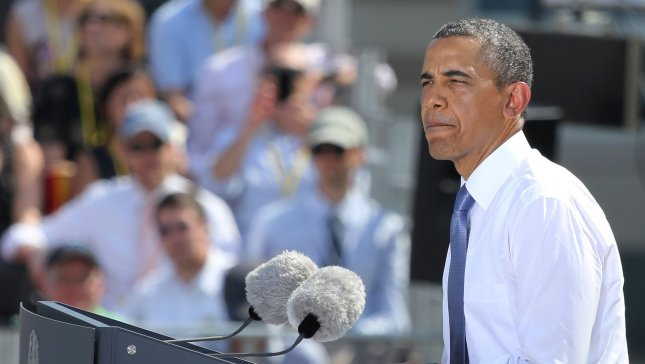 U.S. President Barack Obama speaks at the Brandenburg Gate in Berlin on June 19, 2013. Obama is in Berlin on his first official state visit to Germany and after meeting with German Chancellor Angela Merkel, spoke at the historic site where fifty years earlier U.S. President John F. Kennedy delivered his famous Ich bin ein Berliner (I am a Berliner) address . UPI/David Silpa