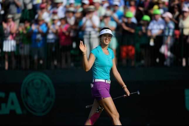 Michelle Wie waves at the gallery on hole 18 during the Final Round of the Women's U.S. Open at Pinehurst No. 2, in Pinehurst, North Carolina, on June 22, 2014. Wie won the tournament with a 2-under-par total score. UPI/David Tulis
