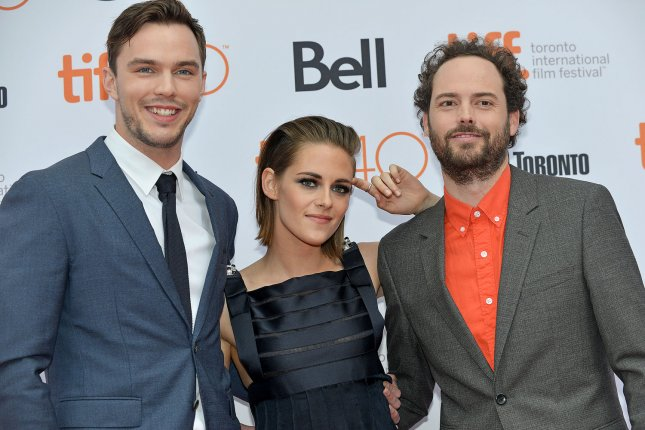 (L-R) Nicholas Hoult , Kristen Stewart and director Drake Doremus arrive at the Toronto International Film Festival premiere of Equals at the Princess of Wales Theatre in Toronto, Canada, on September 13, 2015. File Photo by Christine Chew/UPI