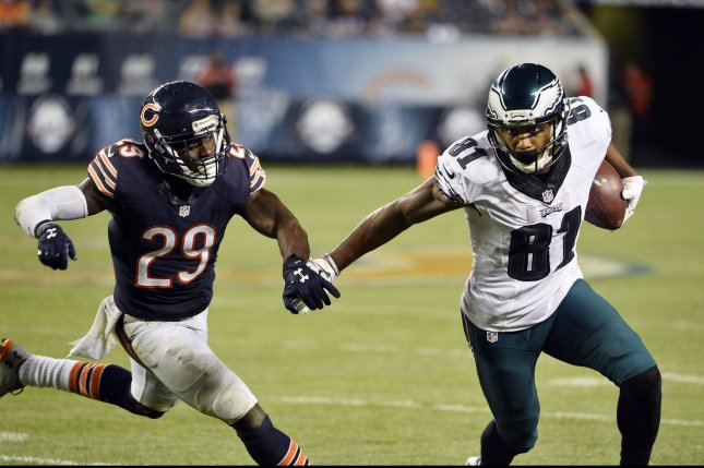 Philadelphia Eagles wide receiver Jordan Matthews (R) runs after a catch for a 7-yard gain and a first down to ice the game as Chicago Bears strong safety Harold Jones-Quartey chases him during the fourth quarter at Soldier Field in Chicago on September 19, 2016. The Eagles defeated the Bears 29-14. Photo by Brian Kersey/UPI
