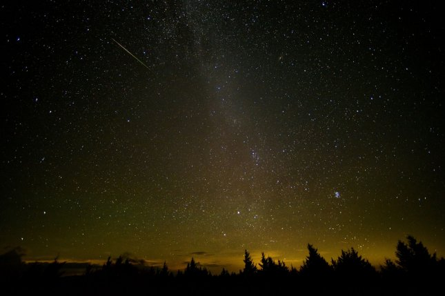 A meteor streaks across the sky during the Perseid meteor shower in August 2016. This week, London-based scientists presented findings of a study that sourced mysterious flashes of light in space, called FRBs, that had baffled astronomers for a decade. NASA Photo by Bill Ingalls/UPI